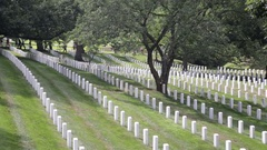 Headstones and graves at the Arlington National Cemetery, wide Stock Footage