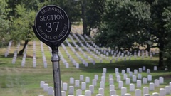 Section marker and headstones at the Arlington National Cemetery Stock Footage