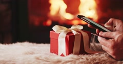 Man Hands Using SmartPhone, online shopping by Fireplace. 4K SLOW MOTION Stock Footage