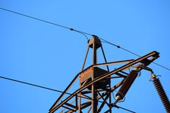 Detail of old transmission tower also power tower or electricity pylon Stock Photos