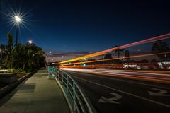 Blurred headlights at night in Ventura Stock Photos