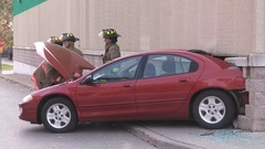 Car accident with car crashed into building wall in parking lot Stock Footage