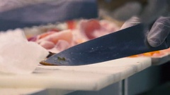 Cooking food in a restaurant kitchen. Chef's hands cut the meat at the kitchen Stock Footage