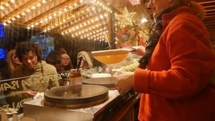 Christmas pancakes  crepes making at Christmas market Stock Footage