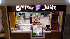 Aerial view of worker preparing fruit for sale inside Booster Juice shop Stock Footage