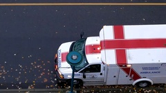 Aerial view of medical team driving ambulance car with injured patient Stock Footage