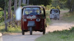 """Two """"Tuk Tuk"""" on a path in the countryside Stock Footage"""
