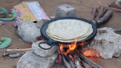 Cooking Indian bread over the fire Stock Footage
