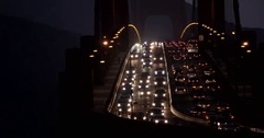 Traffic on rush hour at the Golden Gate Bridge by night Stock Footage