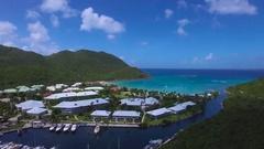 4K Aerial lift reveal shot at Anse Marcel, St Maarten, Okt 2016 Stock Footage
