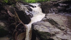 Aerial Close Up on Waterfall Winding Down Rocky Forest Canyon Stock Footage