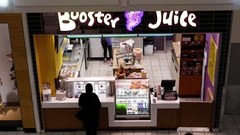 Aerial view of people ordering drink at Booster Juice shop Stock Footage