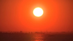 Fireball red sunset by Toronto island airport Stock Footage