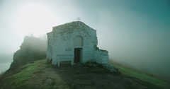 Medieval chapel surrounded by mist at sunrise-timelapse Stock Footage