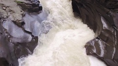 Close Up Drone Shot Flying Low Over Rocky Canyon Waterfall Stock Footage