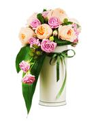 Colorful flower bouquet from roses and peon flowers in vase isolated on white Kuvituskuvat