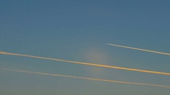 Aircraft trail in blue sky. Stock Footage