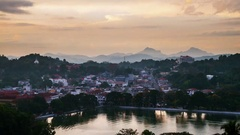 Lake in Kandy at sunset. Time-lapse of clouds and city life Stock Footage