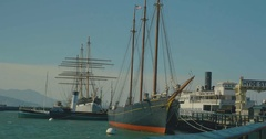 Old sail ships sitting at the pier in San Francisco Stock Footage