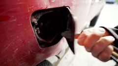 Filling Up Gas Putting Nozzle Into Old Dirty Muddy Red Truck With Key Lock Stock Footage