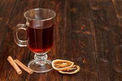 Compote or tea with fruit ingridients, dried orange, cinnamon. Copyspace Stock Photos