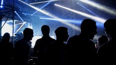 Silhouettes of people at music festival. Close-up Stock Footage