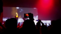 People taking photos or recording video with their smart phones at music concert Stock Footage
