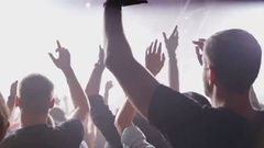Crowd dancing at music concert. Close-up Stock Footage