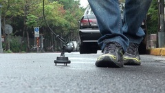 An operator is using a water leak detector on a road of Taipei city, Taiwan. Stock Footage