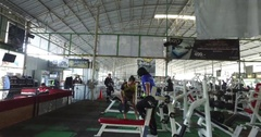Thai gym floor activity pan shot with people working out Stock Footage