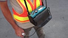 An operator is adjusting the water leak detector Stock Footage