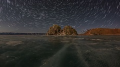 4K. Starry night over the island Olkhon. Burkhan Cape, Olkhon island, Lake Ba Stock Footage