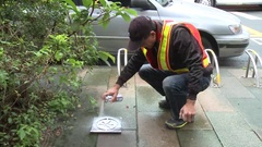 An operator is marked with paint the point where a water leak. Stock Footage