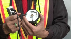 A worker is showing in his hands a water leak detector. Stock Footage