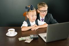 Back to school. Business kids smiling, uses laptop Stock Photos