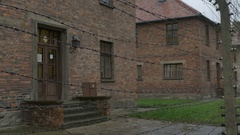 Barbed Wire at Auschwitz Buildings Stock Footage