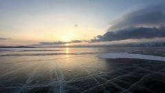 4K. Sunset in the icy Lake Baikal, Irkutsk region, Russia. Ultra HD,  Stock Footage