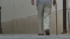Old Man Walking with Cane Stock Footage