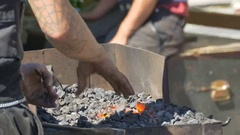 Blacksmith Arranges Coals Stock Footage