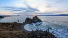 4K. Sunset on Lake Baikal. Burkhan Cape, Olkhon island, Lake Baikal, Irkutsk  Stock Footage