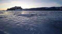 4K. Sunset on the frozen Lake Baikal, Elenka island. Stock Footage