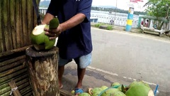 Young buko coconut cut open by bolo Stock Footage