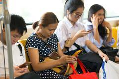 Using smartphone in public transportation Stock Photos
