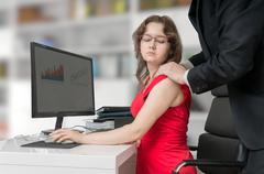 Harassment at workplace. Boss or manager is touching shoulder of his secretar Stock Photos