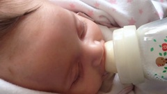 Newborn baby drinking milk from a bottle Stock Footage