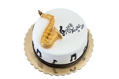 Creative cake tool saxophone, on the day of birth. Stock Photos