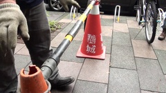 Operators are putting a fence on cones to delineate the area of a water leak. Stock Footage