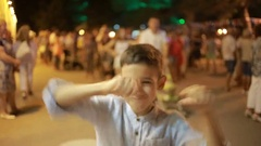 Teenager boy smiling at the camera. night on the street. dances, plays the fool Stock Footage