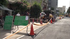 Workers are performing a work on a road in the city of Taipei, Taiwan. Stock Footage