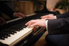 Close-up of a music performer's hand playing the piano Stock Photos